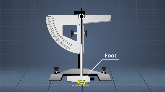 "A pendulum slip resistance tester drags a standardized rubber ""foot"" over a hard surface"