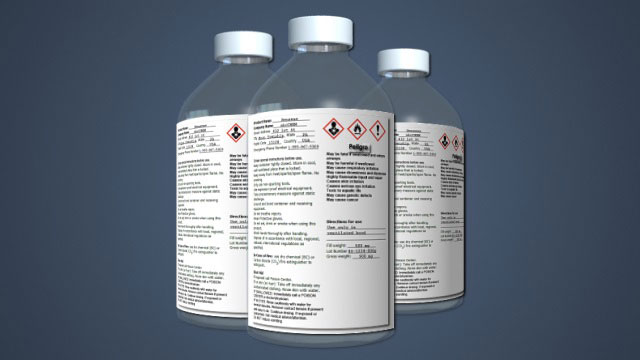 a ghs hazcom label on chemical bottles
