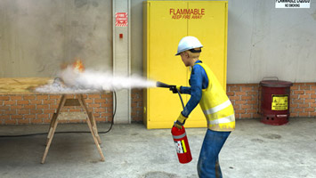 Employee in full PPE using a fire extinguisher to put out fire - screenshot from Convergence Video
